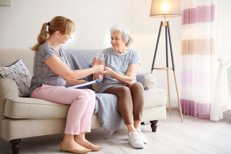 home caregiver assisting senior woman in Toronto